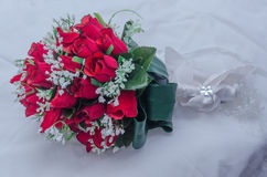 Wedding bridal bouquet of red roses on a white blanket Stock Photos