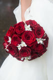 Wedding Bridal bouquet of red roses and white flowers. Stock Photography