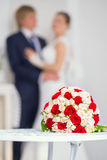 Wedding bridal bouquet with red and white roses on the table aga Stock Photos