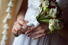 Wedding Bridal bouquet with rings. In hand Stock Photos