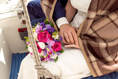Wedding Bridal bouquet with rings. In hand Royalty Free Stock Images