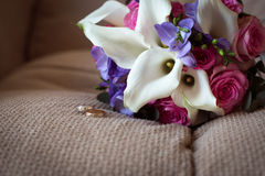 Wedding Bridal bouquet with rings. In hand Royalty Free Stock Image