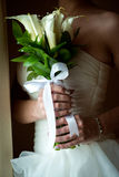 Wedding Bridal bouquet with rings. In hand Royalty Free Stock Photography