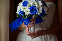 Wedding Bridal bouquet with rings. In hand Royalty Free Stock Photo