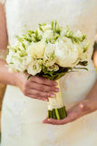 Wedding Bridal bouquet with rings. In hand Stock Images