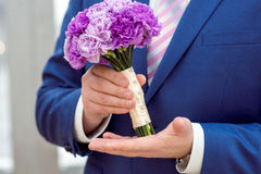 Wedding Bridal bouquet with rings. In hand Royalty Free Stock Photos
