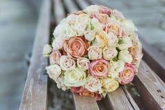 Bridal bouquet of rose flowers. Wedding. Bridal bouquet of rose flowers on wooden background Royalty Free Stock Photos