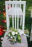 Wedding bridal bouquet with roses on the chair Royalty Free Stock Images