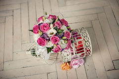 Wedding bridal bouquet of roses on the wooden   floor Stock Image