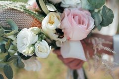 Wedding bridal bouquet in the rustic style on which the bee sits.  royalty free stock photography