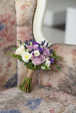 Wedding bridal bouquet on a sofa. Violet wedding bouquet on a sofa Royalty Free Stock Images