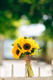 Wedding bridal bouquet of sunflowers on a metal fence. Wedding i Royalty Free Stock Photography