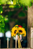 Wedding bridal bouquet of sunflowers on a metal fence. Wedding i Royalty Free Stock Photo
