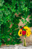 Wedding bridal bouquet of sunflowers in on a stone bench and han. Ging on the background of green leaves. Wedding in Montenegro, Perast royalty free stock photos
