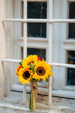 Wedding bridal bouquet of sunflowers on the window. Wedding in M Stock Photo