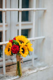 Wedding bridal bouquet of sunflowers on the window. Wedding in M Royalty Free Stock Images