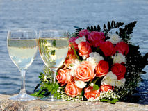 Wedding bridal bouquet. And two glasses of champagne Stock Photos