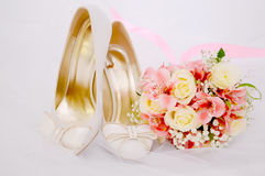 Wedding bridal bouquet Wedding bouquet of red and pink white flo. Wers lying on the fabric next to the bride`s shoe Stock Image