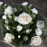 The Wedding bridal bouquet of white roses, carnations and tulips in brown kraft paper Royalty Free Stock Photos