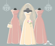 Wedding bridal and bridesmaid dresses set. Composition of the three bride and bridesmaid wedding dresses,Bridal veil,bouquet,handbags and high heel shoes. Bridal Stock Photography