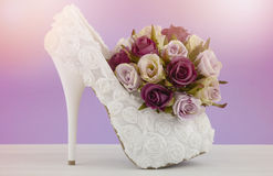 Wedding Bridal concept with white floral high heel shoe and rose Stock Images