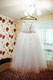 Wedding bridal dress on a custom hanger Stock Photography