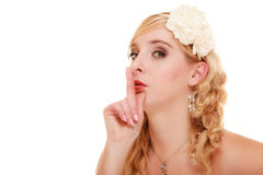 Wedding. Bride asking for quiet. Finger on lips. Royalty Free Stock Photography