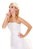 Wedding. Bride asking for quiet. Finger on lips. Royalty Free Stock Photo