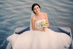 Wedding bride on a boat on the lake Royalty Free Stock Photo