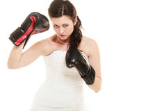 Wedding. Bride in boxing gloves. Emancipation. Emancipation. Bride in wedding dress wearing boxing gloves. Woman showing her power domination isolated stock image