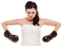 Wedding. Bride in boxing gloves. Emancipation. Emancipation. Bride in wedding dress wearing boxing gloves. Woman showing her power domination isolated royalty free stock images