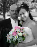 Wedding Bride and Groom. Bride and groom just before the wedding. Black and white with only the flowers in color Royalty Free Stock Photos