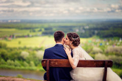 Wedding Bride and groom on a bench with nature landscape scenery background Stock Images