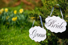 Wedding bride and groom boards outdoors Royalty Free Stock Photos
