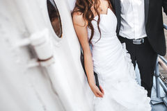 Wedding bride and groom on deck of boat, stylish couple. Stock Photos