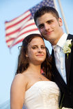 Wedding - bride and groom with flag stock photos