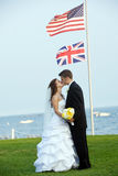Wedding - bride and groom with flag Stock Photo