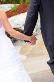 Wedding - Bride and Groom Holding Hands Royalty Free Stock Images