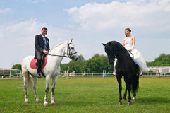 Wedding bride and groom on horseback Stock Photo