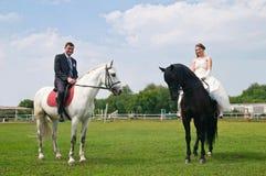 Wedding bride and groom on horseback Stock Photo