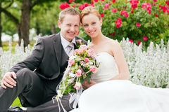 Wedding - bride and groom in a park Royalty Free Stock Image