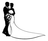 Wedding Bride and Groom Silhouette. Wedding couple bride and groom in silhouette, in a bridal dress gown holding a floral bouquet of flowers Stock Photography