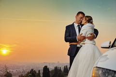 Wedding. Bride and Groom at sunset stock image