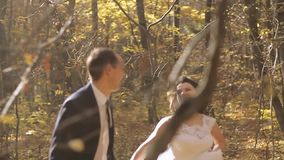 Wedding Bride And Groom Walk in a Autumn Forest. Happy moments. Slow motion stock video footage