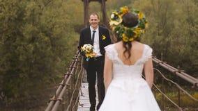 Wedding Bride and Groom Walk on Wooden Bridge. Slow motion stock video