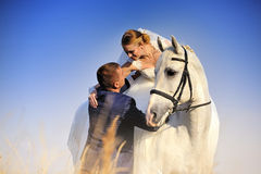Wedding. Bride and groom with white horse Royalty Free Stock Image