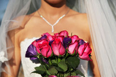 Wedding. Bride holding a wedding bouquet with zooming filter stock photos