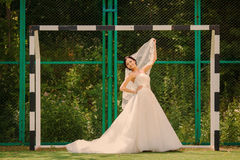 Wedding bride at the stadium Royalty Free Stock Photos