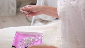Wedding, bride wears dress, shoes, jewelry. Wedding, bride wears dress shoes jewelry stock video footage