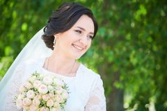 Wedding. bride portrait in park. Wedding and bridegroom. happy the newly married bride portrait outdoors stock images
